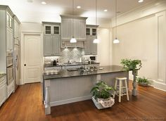white walls and ceilings with grey cabinets and hard wood floors