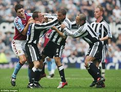 Newcastle United's Lee Bowyer (second from left) and Kieron Dyer (centre) fight on the pit...
