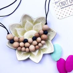 Silicone and beech teething/nursing necklace: woven bib style
