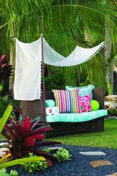 Carribbean-inspired....using outdoor fabrics for the garden.....like this