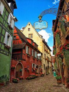 Cobblestone Street, graced by flowers Alsace, France
