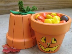 Terra Cotta Pumpkin Pots: These cute pots are great as a table decoration, or turned upside down they make fun treat holders. Provide the paint and markers at your Halloween or harvest party, and this makes a great project for your guests.