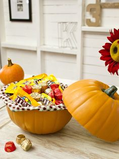 http://www.hgtv.com/entertaining/how-to-make-a-pumpkin-candy-dish/index.html    An artificial pumpkin and fall-themed fabric make a great container for Halloween treats.    medium or large artificial pumpkin  1/2 yard of burlap or any fall-themed fabric  X-Acto or pumpkin-carving knife  2 thumbtacks  1 yard of yarn or thin rope  pencil  Halloween candy