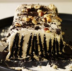 Bday cake for Sam - Coffee & Cream Icebox Cake--Coffee and hazelnuts give this cake—a variation on Nabisco's Famous Wafer Roll recipe—a more sophisticated flavor. Via FineCooking Icebox Desserts, Icebox Cake Recipes, Frozen Desserts, Fun Desserts, Delicious Desserts, Dessert Recipes, Summer Desserts, Frozen Treats, Dessert Ideas