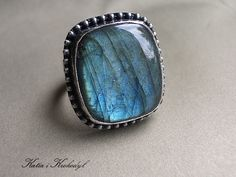 £49.00    Ring made of silver [hallmarks 925, 930 and 999] in combination with the labradorite [18mm x 20mm]. Oxidized and frayed. The ring will fit size 16-17 jewelry. Decoratively wrapped.