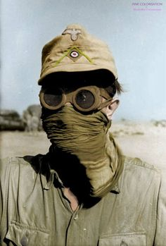 A German soldier of the Deutsches Afrikakorps protects his face and eyes with goggles and a scarf from desert sandstorms during the North African Campaign. Tunisia. April 1941.