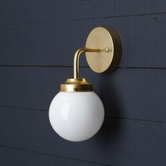 This Vintage Brass Wall Sconce fixture features-Raw Brass Mount-Raw Brass pipe-Milk Glass Globe -110 / 220 Volt-60 Watts Max-Universal Mounting Bracket and Scre