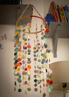 Homemade baby mobile from Seeds and Stitches. Definitely will use the fabric-covered embroidery hoop plan when I make mine...