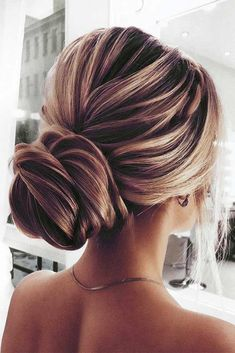 A chignon hairstyle: you have definitely heard about it, but what is it exactly? In its essence, it is an updo that involves a bun that is situated at the neck nape though the placement of the bun varies. Look for out collection of the best chignon hairstyles! #chignon #chignonhairstyles