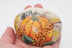 Fall pumpkin painted stone stone painting by EmmysHeartsnCrafts