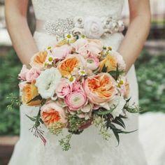 Orange, coral mixes bouquet.