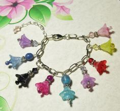 Check out this awesome Beaded Lucite Flowers Charm Bracelet in Rainbow colors Handmade Jewelry Adjustable to 8.5 inches on eBay www.grammysbargains.com FREE SHIPPING IN USA