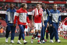 Danny Welbeck (second right), pictured applauding the Arsenal fans, has been ruled out of the FA Cup final