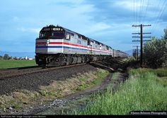 A well tuned quartet of F40PH engines pull the California Zephyr train No. 6 less than 10 minutes from its scheduled stop at Provo, Utah on May 15, 1989.