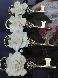 Key Boutonniere. With a magnolia. Bride and bridesmaids have locks on their bouquets. Only key that will fit bride's lock is the groom's.
