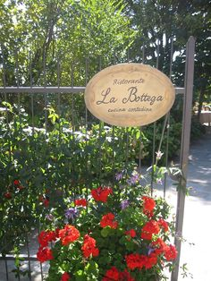 Restaurant in Tuscany - love the sign and the flowers