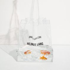 Limited Edition HELMUT LANG PVC Bag AVAILABLE TO THE FIRST 100 SHOPPERS IN OUR NY AND LA STORES 821 WASHINGTON ST, NY 8808 MELROSE AVE,…