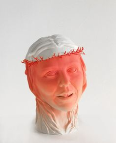 Blossoming by Mariette Van Der Ven, 2012. Sculpture with red coral.