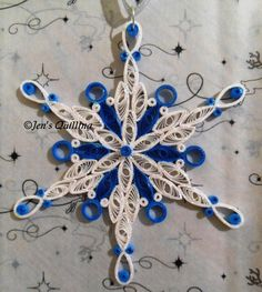 Quilled Snowflake Ornament by JensQuilling on Etsy https://www.etsy.com/listing/246634364/quilled-snowflake-ornament