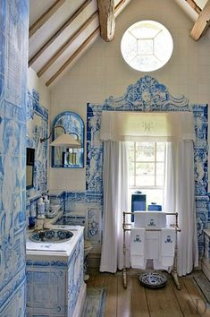 At Anouska Hempel's English country house, a vanity is covered in trompe l'oeil tiles painted by Kaffe Fassett according to a design by Hempel. Architectural Digest Trompe l' oeil blue and white. Architectural Digest, Blue Rooms, White Rooms, Moldings And Trim, White Tiles, Blue Tiles, Traditional Bathroom, White Bathroom, French Bathroom