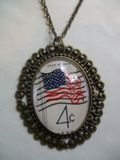 4 cent 1960 flag postage stamp necklace by NoTwoTheSame on Etsy, $15.00