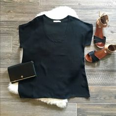 Lush Black Top Loose fitting, short sleeve top. Front is a little shorter than the back. Gently used- only worn a few times and in great condition! Pairs well with light wash or destroyed denim. No trades, reasonable offers welcome! Lush Tops Tees - Short Sleeve