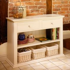 Silbury console table from The Cotswold Company  Paint dark grey and replace rattan baskets with brightly coloured boxes