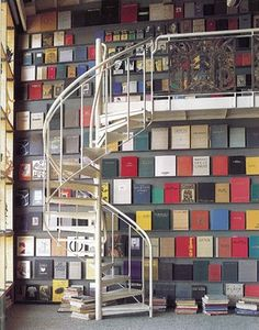 what a great idea for displaying books - skinny shelves all up and down your walls to display books side by side