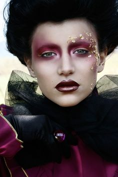 Plum and gold makeup. This is very avant-garde