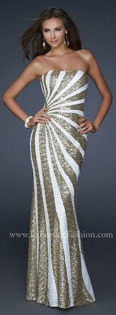 Oh dear, someone please invite me to a red carpet event!  I think I could rock this dress.