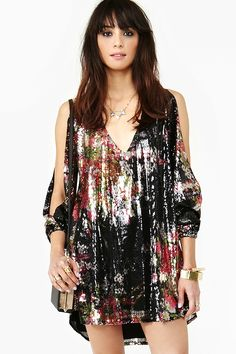 Not your average sequin party dress - so short and low cut it's sexy without being tight