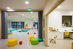 Šmartno Kindergarten designed by Jure Kotnik | bifolding screens and large sliding doors allow the space to be partitioned off