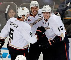 Anaheim Ducks' Corey Perry (10), right, celebrates with teammates Ben Lovejoy (6) and Ryan Getziaf