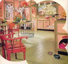 Pink 1960's kitchen. Dog house in the cabinet- awesome!