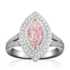 Classic and contemporary in its design, this Fancy Intense Purplish Pink diamond is set notably amongst two rows of impressive brilliant cut diamonds – wistfully revealed on this signature, double row band. This stunning ring was created by Boodles Jewelry CLICK HERE TO PURCHASE