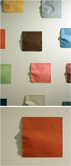 Popular Pix fascinating paper art. shadow cast from the paper is a face