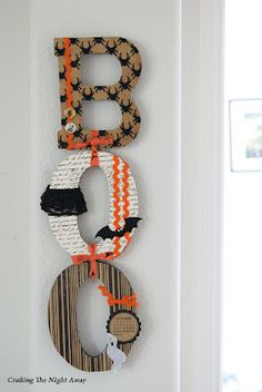 DIY Boo Letter Decor - cute! used burlap, wallpaper and spider garland .love it
