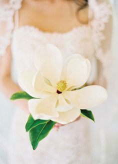 11 Remarkable Single-Flower Wedding Bouquets: Silky White Magnolia. This bold bloom has simple yet classic lines.