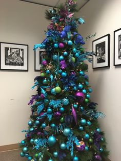 Turquoise blue green and purple Christmas tree. Purple Christmas Tree Decorations, Peacock Christmas Tree, Turquoise Christmas, Blue Christmas Decor, Real Christmas Tree, Christmas Tree Design, Colorful Christmas Tree, Christmas Colors, Coastal Christmas