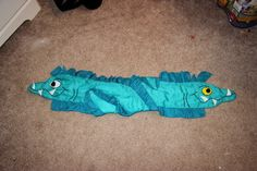 FLOTSAM & JETSAM URSULA'S POOPSIES    Tutorial                 What you'll need:   5/8yd Dark Blue/Green Fabric for the Fins   1yd Light Bl...