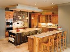 Rustic Cherry Cabinet. Stone Over Cooktop
