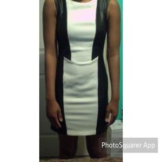 Black and off white dress Black outside trim is a faux leather. Back zipper. Dress is fully lined. Never worn except to photograph in. H&M Dresses