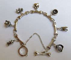 Sterling Silver Dog Charm Bracelet. $295.00, via Etsy.