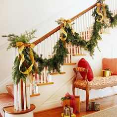How to Store Faux Fir Garlands. I do this, but also organize them by indoor & outdoor garlands & areas (ie: Garlands: driveway area, Garlands: front porch, Garlands: living room, etc). Plus,i like the DIY natural greenery garland & gold bows ribbons on this staircase. Luv the trends of simple bows like grandma made!