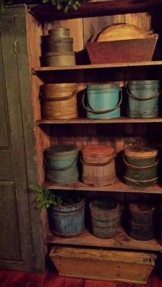 Collection of painted firkins and buckets