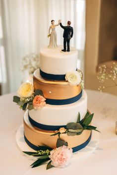 Gold, white and navy wedding cake: http://www.stylemepretty.com/little-black-book-blog/2015/05/15/romantic-spring-wedding-at-turnip-rose-garden-promenade/ | Photography: Joel Bedford - http://joelbedfordweddings.ca/