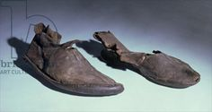 Credit: Shoes, Anglo-Saxon, c.5th-10th century (leather), Anglo-Saxon / Ashmolean Museum, University of Oxford, UK / The Bridgeman Art Library