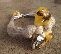 Bracelet | DreamsFactory Designs.  Milky natural baltic amber and linen.