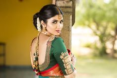 What an well-crafted wedding blouse design this is! The temple tower on the sleeves to the temple jewellery inspired details at the back make this one magnificent masterpiece! Check out more wedding blouse designs on Wedding Vows. Beautiful Girl Indian, Most Beautiful Indian Actress, Beautiful Girl Image, Saree Blouse Designs, Blouse Patterns, Bride Accessories, Beauty Full Girl, India Beauty, Chennai