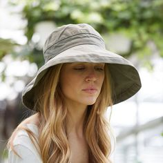 """Handmade from lightweight and breathable cotton, this colorful crusher hat is perfect for a day at the beach or in the garden. Packable construction pairs with UPF 50 sun protection and an inner drawstring to assure a comfortable fit.- Cotton- Spot clean- Imported23"""" crown, 5"""" brim"""